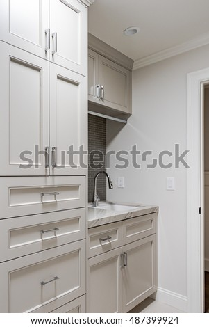 Clean Laundry Room, built-in shelving