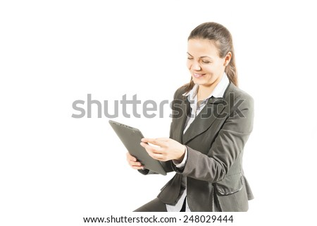 Clean modern portrait of a mature professional business woman with ample copy space. Isolated on white background. Woman using digital tablet computer PC, happy, isolated on white background. - stock photo