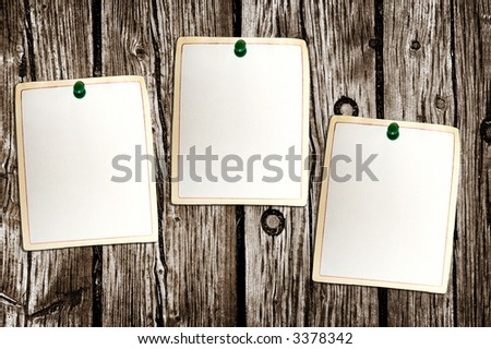 Clean paper sheets attached to the wooden background - stock photo