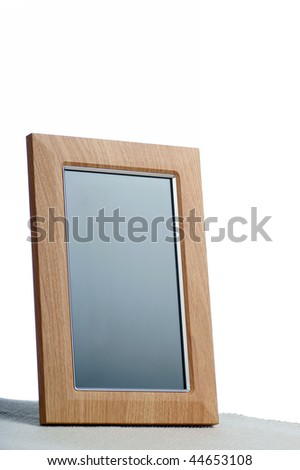 clean photoframe on the table in white background - stock photo