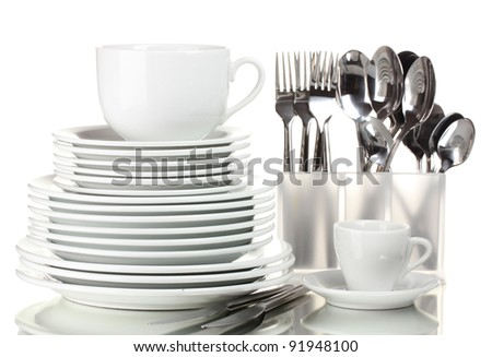 Clean plates, cup and cutlery isolated on white - stock photo
