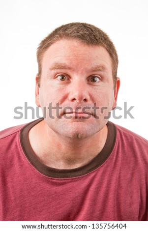 Clean shaven Caucasian male leaning forward and making a weird or funny face - stock photo