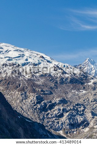 Clean snow capped mountains surrounding Glacier Bay - stock photo