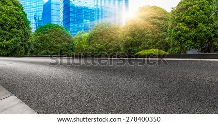 clean street go through the city at shanghai china. - stock photo