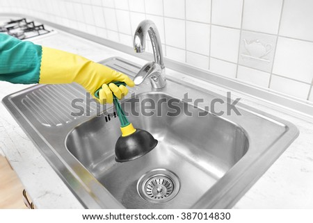 Clean the sinks outflow. Hands and pump. - stock photo