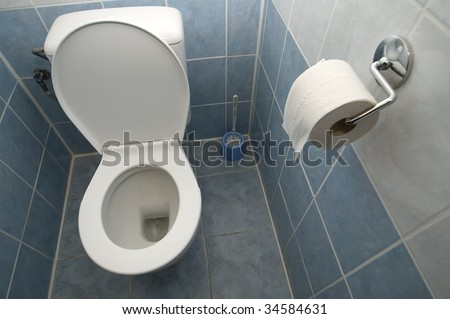 clean toilet interior, tiled walls and floor
