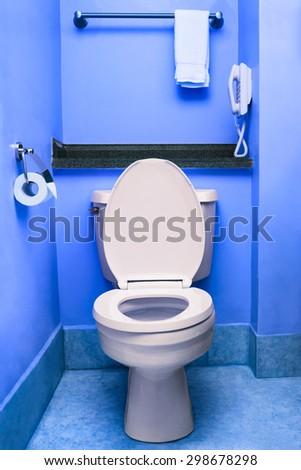 Clean toilet seat bowl restroom blue wc interior washroom hotel - stock photo