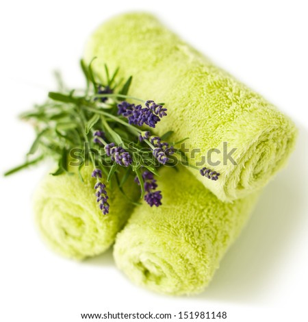 Clean towels with lavender flowers on white- beauty treatment - stock photo