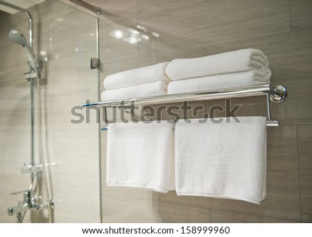 Clean white towel on a hanger prepared to use. - stock photo