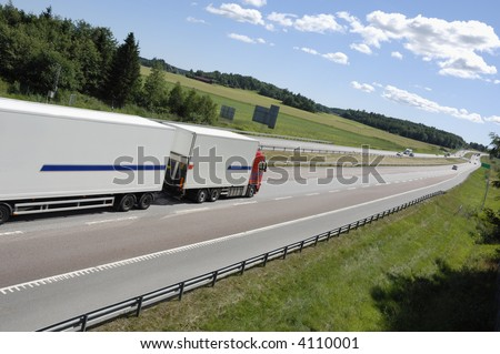 clean white truck on highway surrounded by country-side, no trademarks, stripes are just standard - stock photo