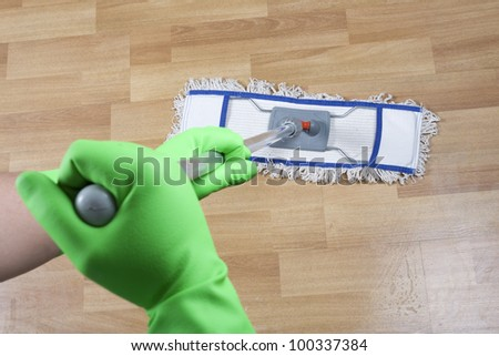 cleaner is mopping - stock photo