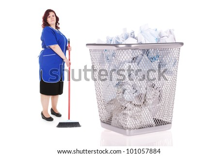 cleaner stands near the big basket with garbage - stock photo