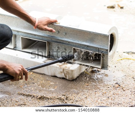 Cleaner to repair refrigeration fan - stock photo