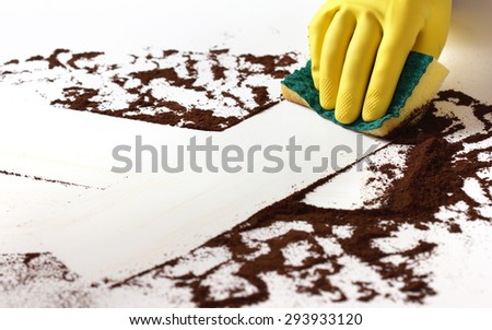 Cleaning a dirty surface - stock photo
