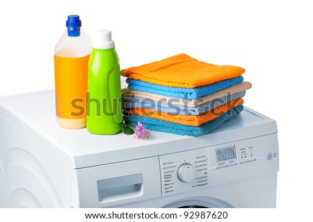 cleaning agents and cloths on a washing machine - stock photo