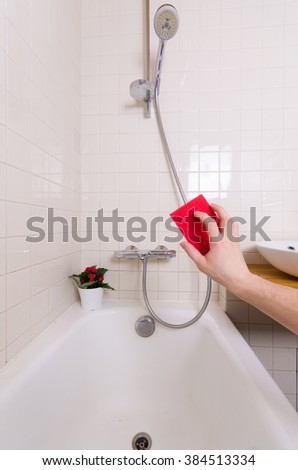 Cleaning bathroom by hand with red reg. view from the Eye - stock photo