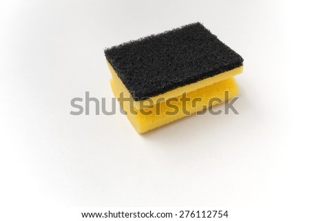 Cleaning black and yellow sponge with space on white background - stock photo