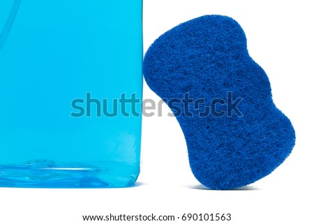 Cleaning bottle and scrub sponge isolated on white