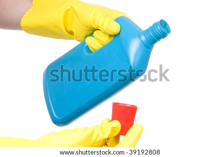 cleaning bottle with janitor or housewife hand in yellow glove isolated