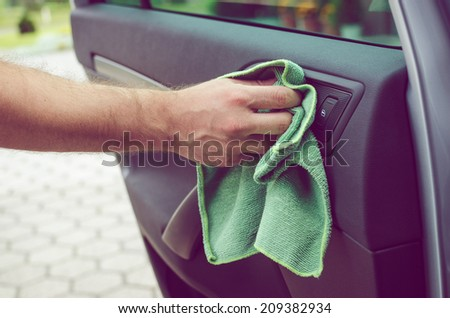 Cleaning car's interior - stock photo