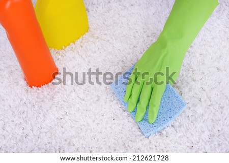 Cleaning carpet with cloth close up - stock photo