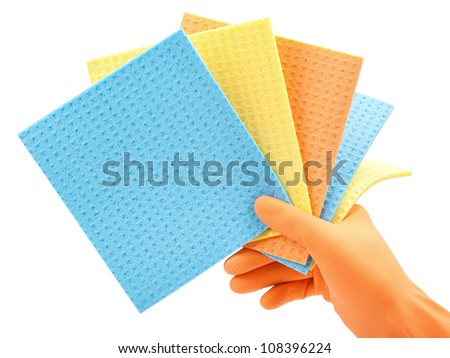 cleaning clothes (kitchen cellulose sponges) in hand in  protective glove on white - stock photo