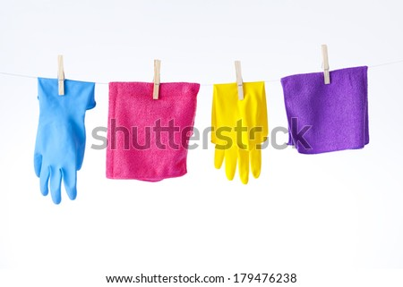 cleaning cloths and gloves on white - stock photo