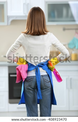 Cleaning concept. Woman with washing fluid and rag, back view - stock photo