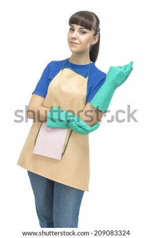 Cleaning Concept: Young Optimistic Housewife with Protective Rubber Gloves Prior To Cleaning.  - stock photo