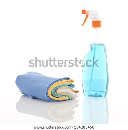 cleaning dusters with bottle cleaning liquid on white - stock photo
