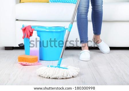 Cleaning floor in room close-up - stock photo