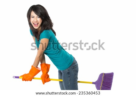 Cleaning girl happy excited during cleaning. Funny girl with cleaning mop playing. isolated on white background