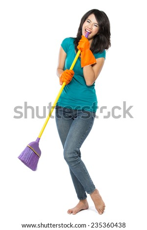 Cleaning girl happy excited during cleaning. Funny girl with cleaning mop playing microphone . isolated on white background - stock photo