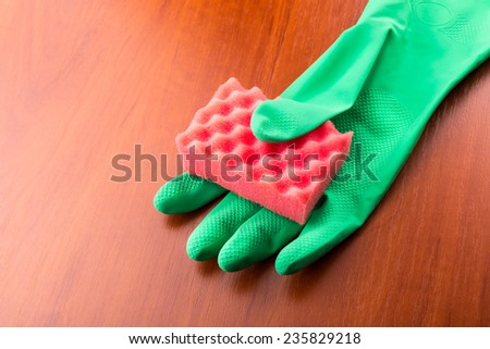 Cleaning glove with a red sponge - stock photo