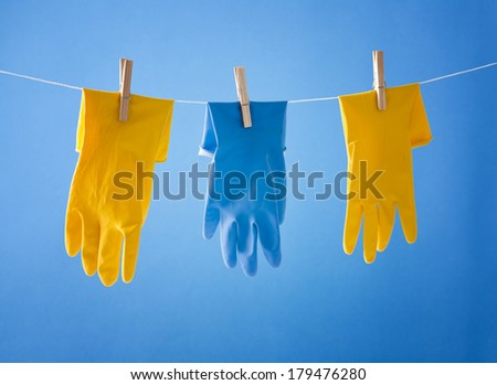 cleaning gloves over blue background