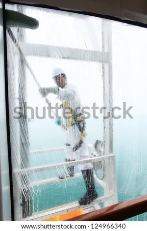 Cleaning he glass window. - stock photo