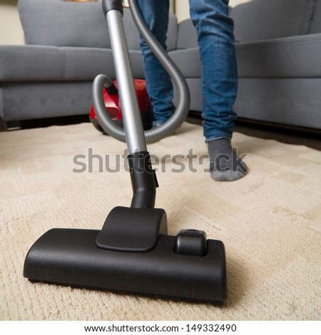 cleaning home with vacuum cleaner  - stock photo