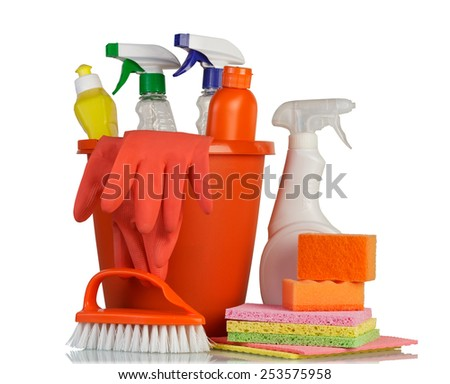 Cleaning items and red gloves isolated on white - stock photo