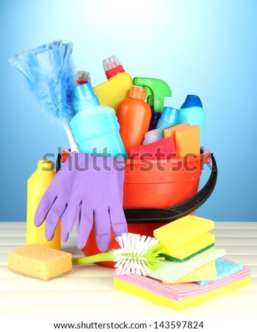 Cleaning items in bucket on  color background - stock photo