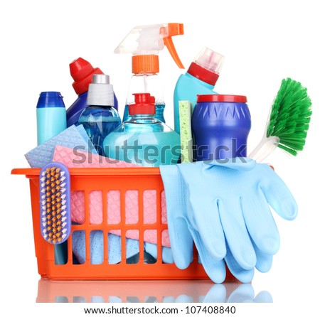 Cleaning items in plastic basket isolated on white - stock photo