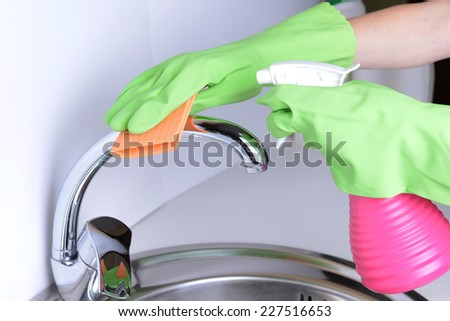 Cleaning kitchen sink close-up