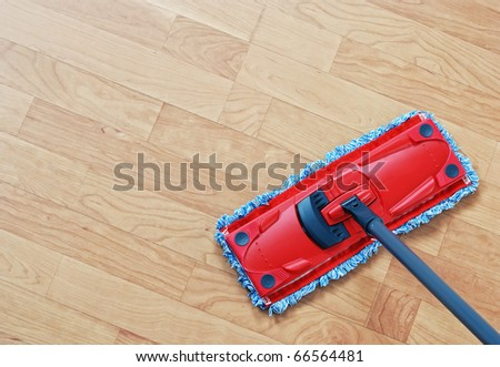 Cleaning laminate. Red mop on hardwood floors.