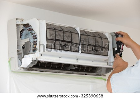 Cleaning of air conditioning - stock photo