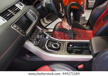 Cleaning of interior of the car with vacuum cleaner, Car cleaning - stock photo