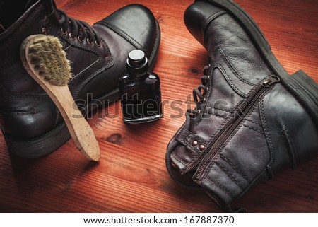 cleaning of men's boots  - stock photo