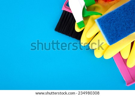 cleaning of rubber gloves on a blue background - stock photo