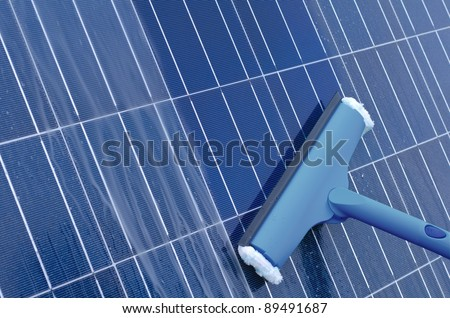 Cleaning of solar panels - stock photo