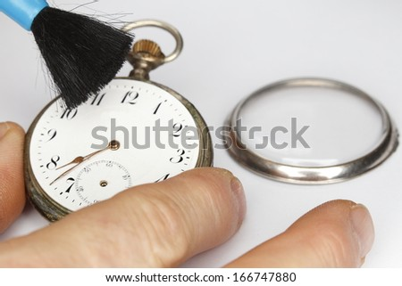 cleaning old clock work,old mechanical watch - stock photo