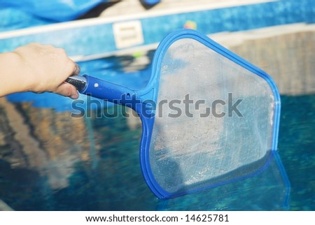cleaning pool sieve - stock photo