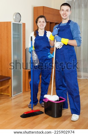 Cleaning premises team cleaning  at home - stock photo